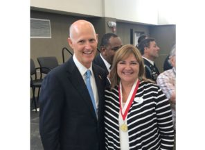 Rebecca with Florida Governor Rick Scott at the Governor's Veterans Service Award ceremony